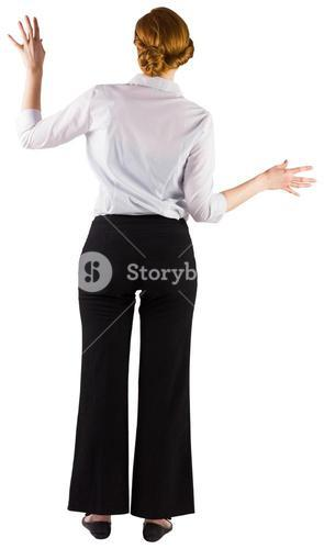 Businesswoman standing with hands out