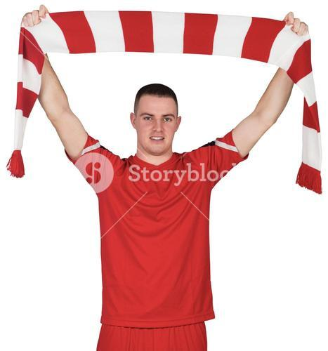 Football player holding striped scarf