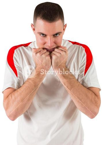 Nervous football player looking at camera
