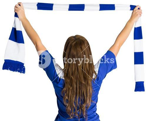 Pretty football fan waving scarf