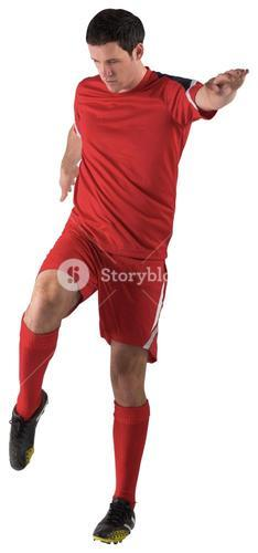 Football player in red kicking