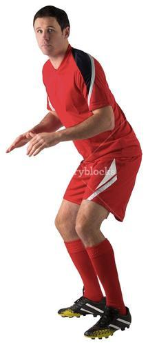 Football player in red standing ready