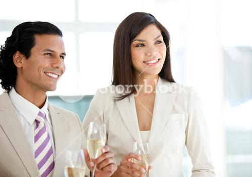 Successful business people drinking Champagne