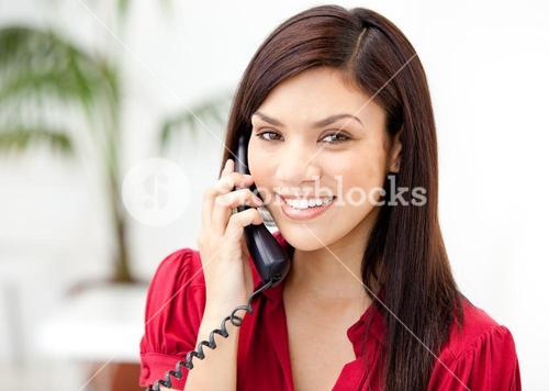 Portrait of a selfassured businesswoman talking on phone