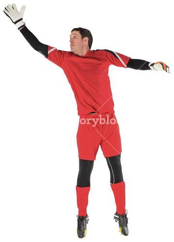 Fit goal keeper jumping up