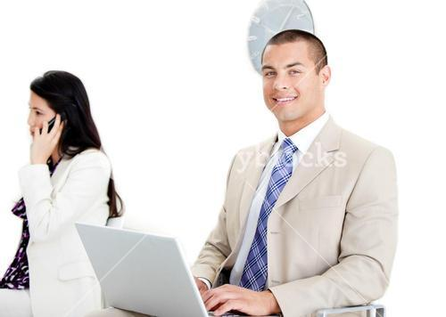 Two business collegues working on a computer