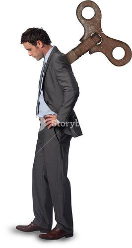 Wound up businessman with hands on hips