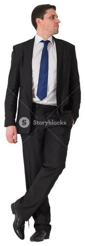 Handsome businessman leaning and looking