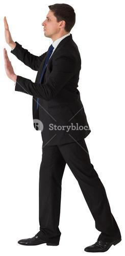 Businessman in suit pushing with hands