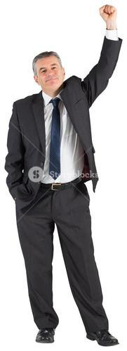 Mature businessman cheering with arm up