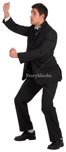 Young businessman standing and pulling