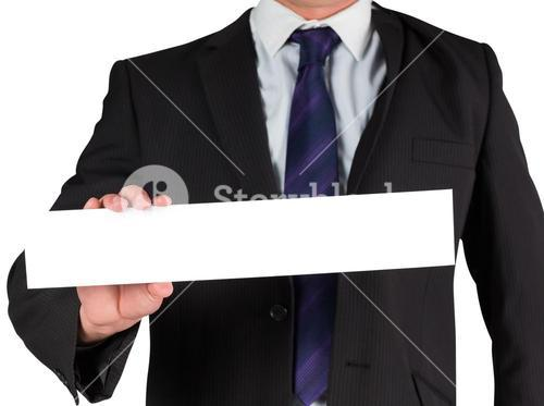 Businessman showing blank white card