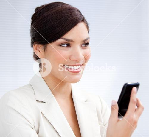 Radiant businesswoman using a mobile phone