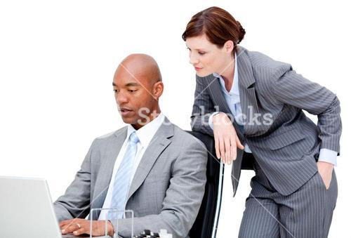 Two business partners working on a laptop