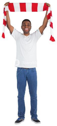 Happy football fan waving scarf