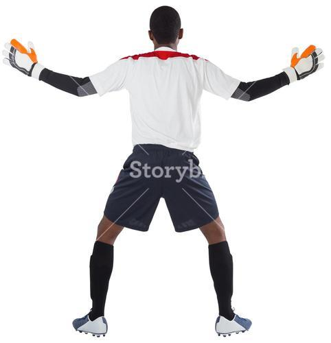 Goalkeeper in white ready to save