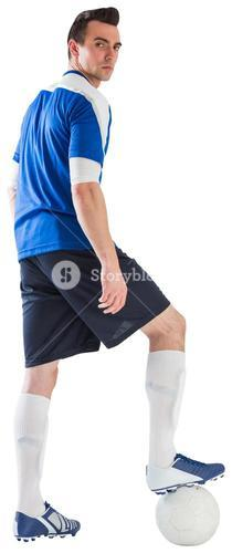 Handsome football player in blue jersey