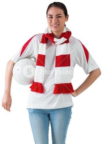 Football fan in white wearing scarf holding ball