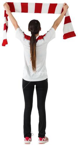 Football fan waving red and white scarf