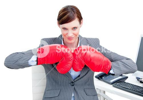 Portrait of a confident businesswoman wearing boxing gloves