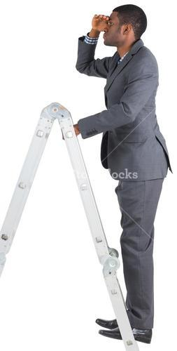 Businessman standing on ladder looking