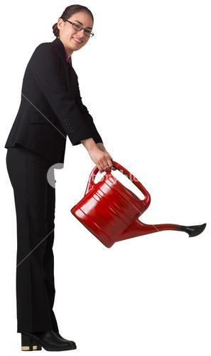 Businesswoman using red watering can