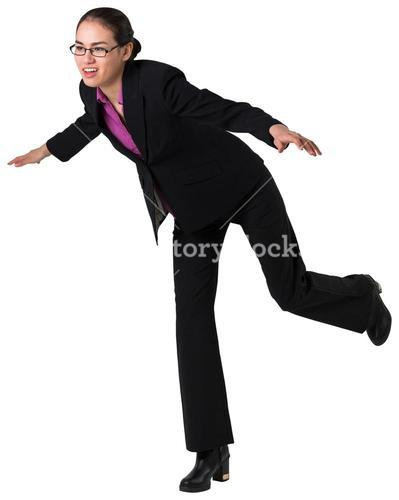 Businesswoman stepping and balancing