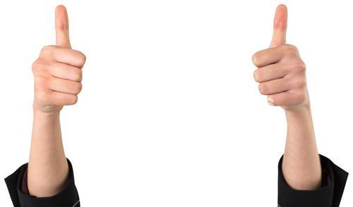 Businesswomans hands showing thumbs up