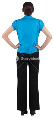 Young businesswoman standing with hands on hips