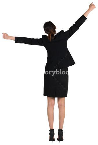 Excited businesswoman cheering