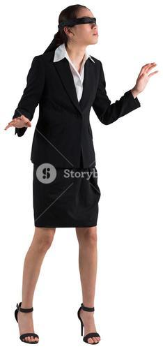 Blindfolded businesswoman with hands out