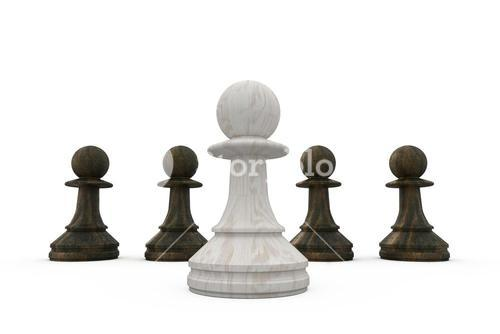 White pawn standing in front of black pawns