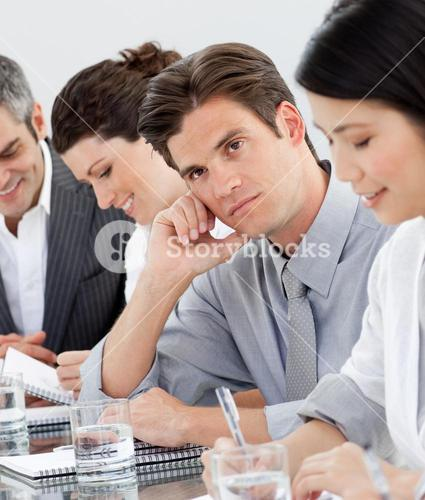 Young businessman bored at a presentation