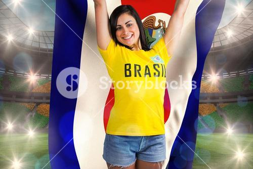 Excited football fan in brasil tshirt holding costa rica flag