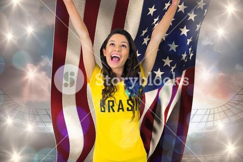 Excited football fan in brasil tshirt holding usa flag