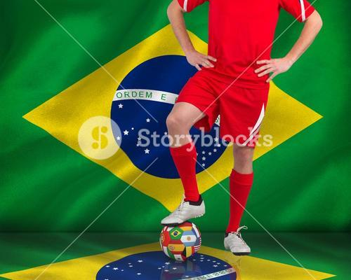 Football player standing with ball