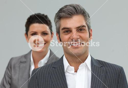 Smiling business associates in a row