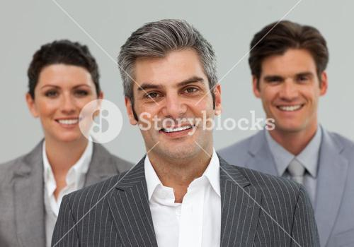Smiling Business associates standing in a line