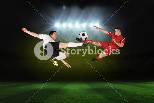 Football players tackling for the ball