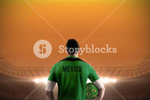 Mexico football player holding ball