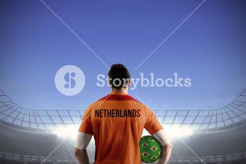 Netherlands football player holding ball