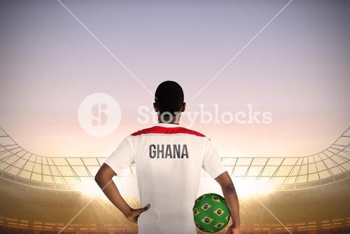 Ghana football player holding ball