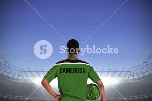Cameroon football player holding ball