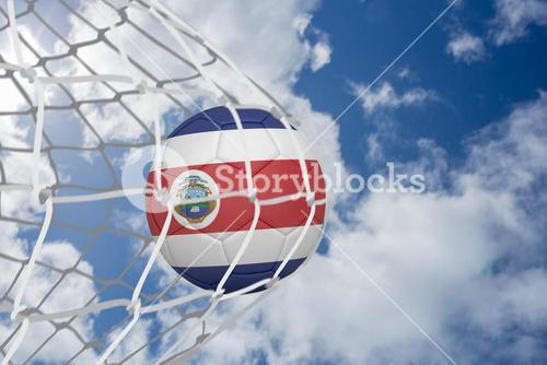 Football in costa rica colours at back of net
