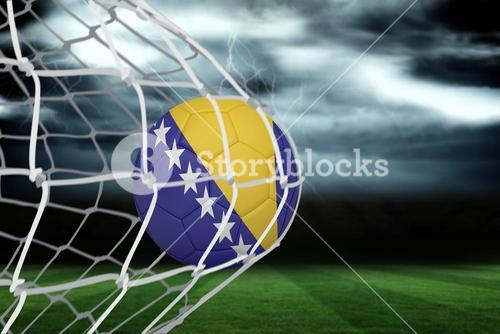 Football in bosnia and herzegovina colours at back of net