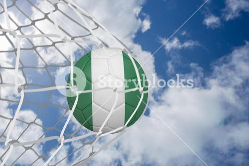 Football in nigeria colours at back of net
