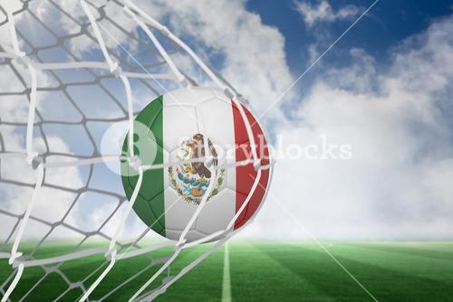 Football in mexico colours at back of net