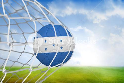 Football in honduras colours at back of net