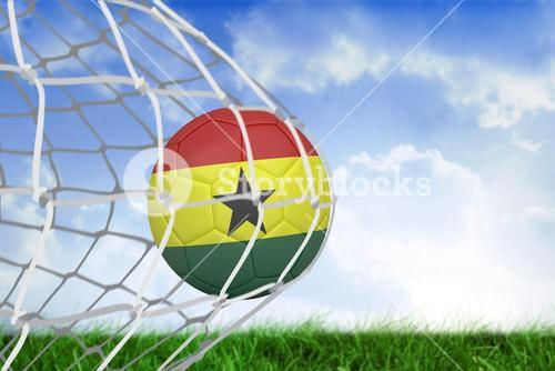 Football in ghana colours at back of net