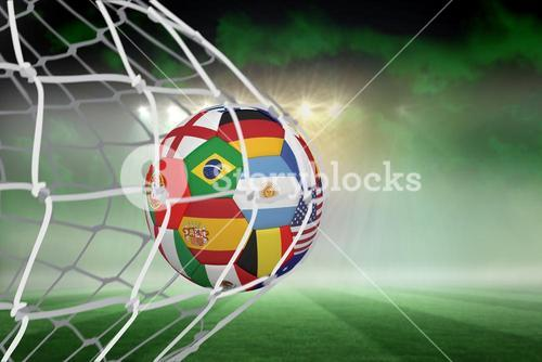 Football in multi national colours at back of net